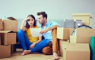 Couple sitting among boxes